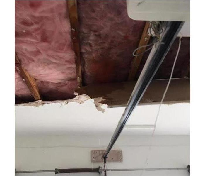 Water damage that leaked through roof onto ceiling.