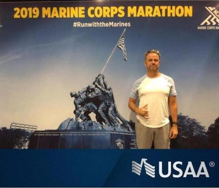 Man in front of USAA poster.