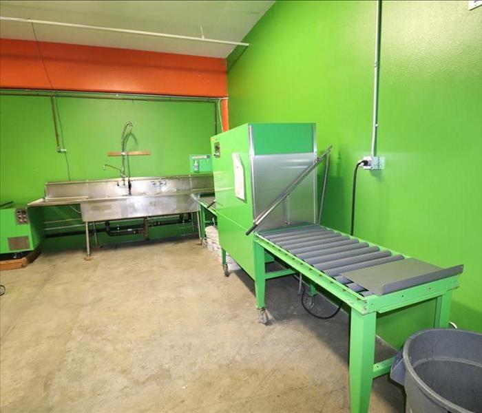 Green room with ultrasonic cleaner and steel tables.