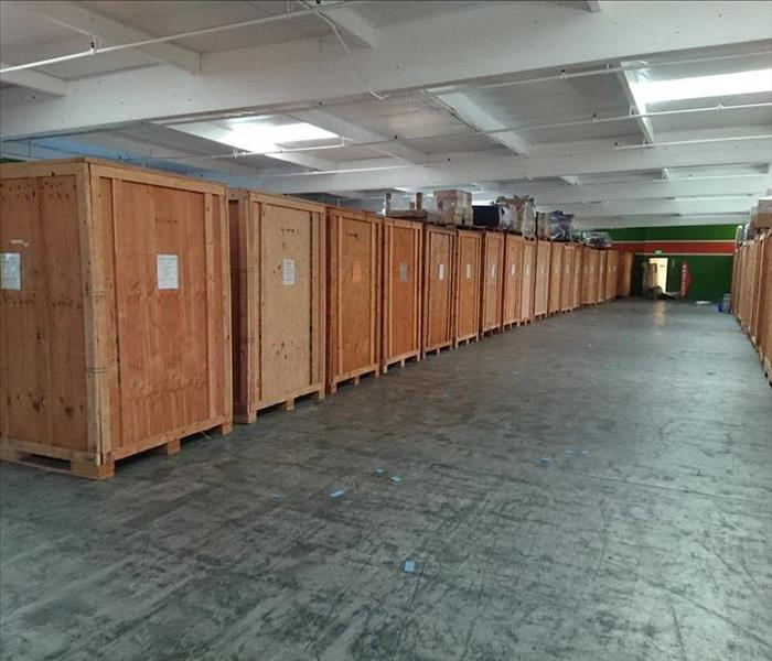 Large warehouse with wooden crates.
