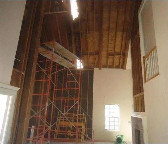 After photo of walls and ceiling removed after a fire.