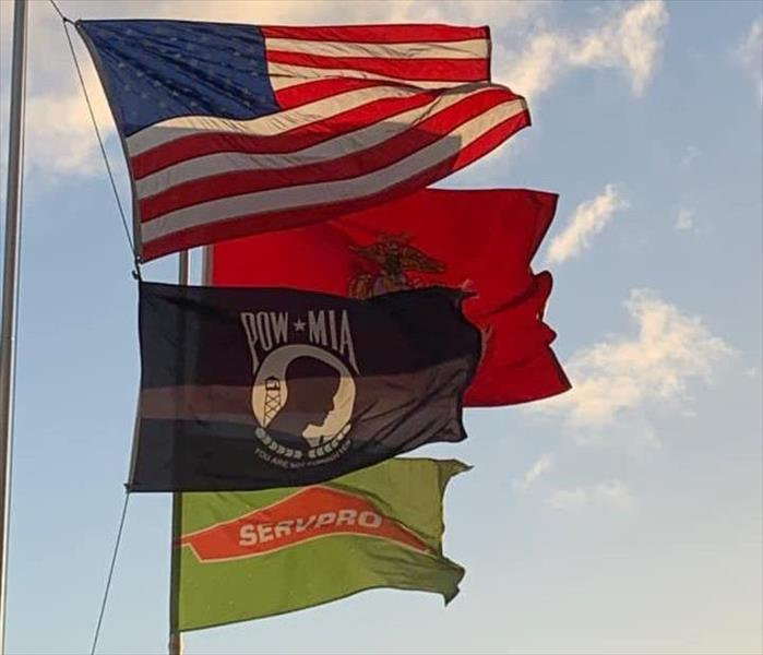 USMC, SERVPRO, POWMIA and USA Flags flying